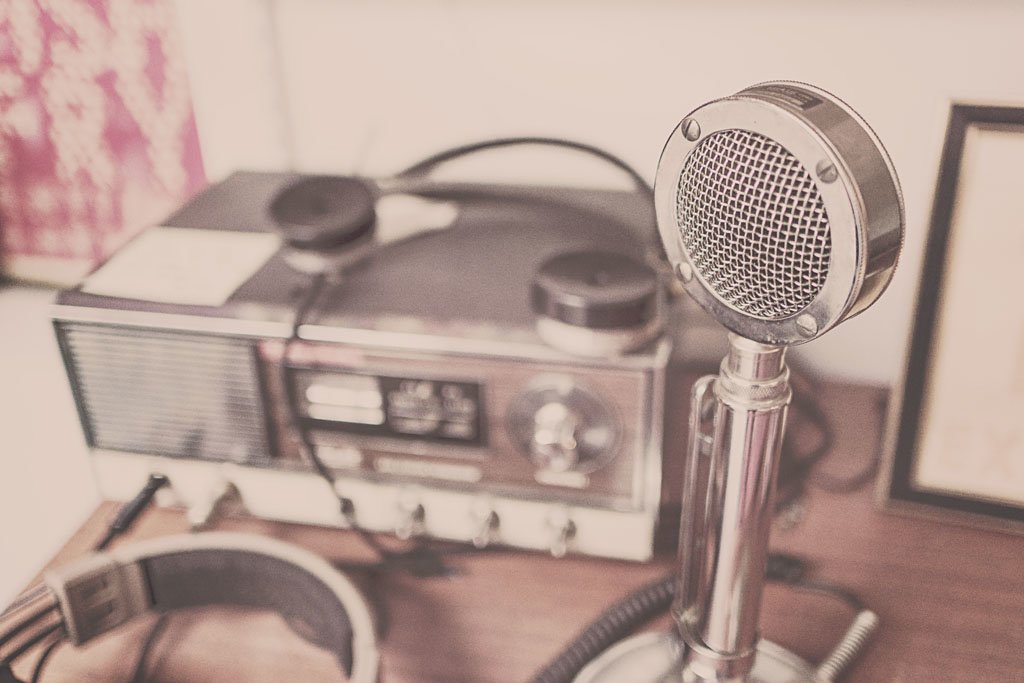 Vintage microphone and radio stock photo
